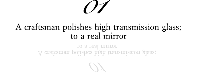 01 A craftsman polishes high transmission glass; to a real mirror